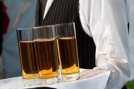 Waiter with dish of wine glasses  Stock fotó