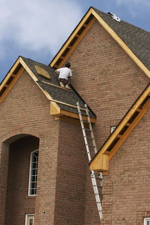 roof shingles: roofer Stock Photo