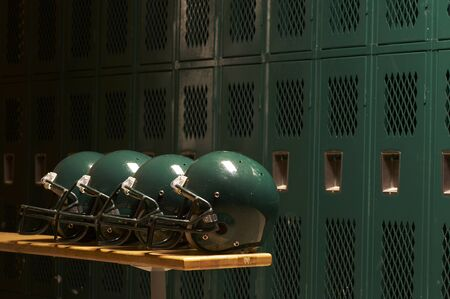 football helmets in locker room