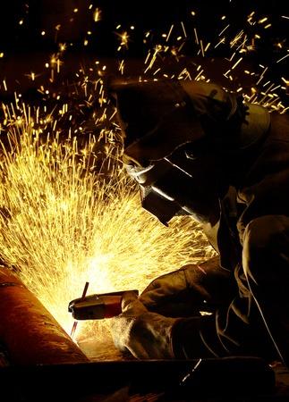 welding metal: arc welder working at night Stock Photo