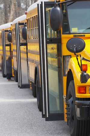 row of buses in front of school