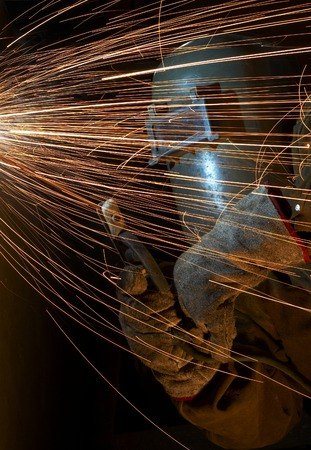 one welder working at night