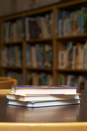 three books stacked on a table Stock Photo - 1895815