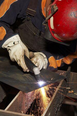 welder at shipyard working on steel project