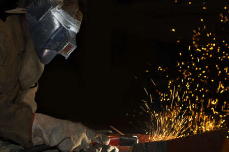 laboring: an arc welder spraying a lot of fire
