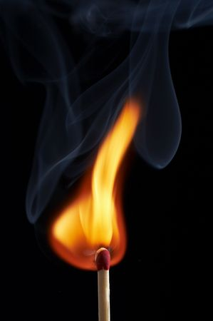 close up macro of a match on fire