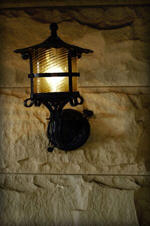 sconce: antique sconce on old brick exterior wall Stock Photo