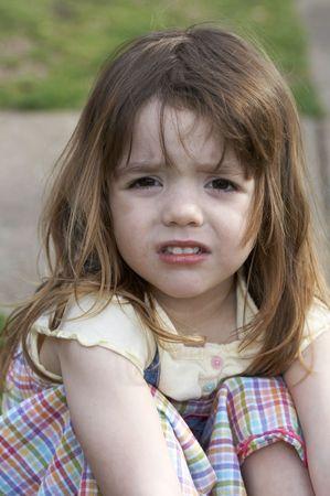 a cute little girl that is upset Standard-Bild