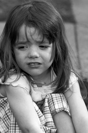 a cute little girl that is upset 版權商用圖片