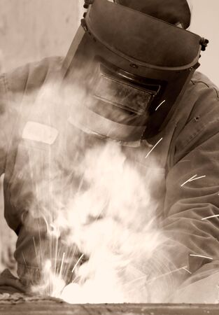 a welder working at shipyard during day Stock Photo