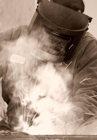 a welder working at shipyard during day Standard-Bild