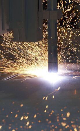 a plasma cutter machine burning steel up close