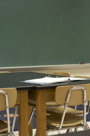 a picture of desks and chalkboard in school classroom photo