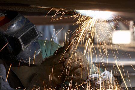a welder working at shipyard during day Reklamní fotografie
