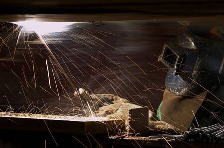 night shift: a welder working at shipyard during night shift Stock Photo