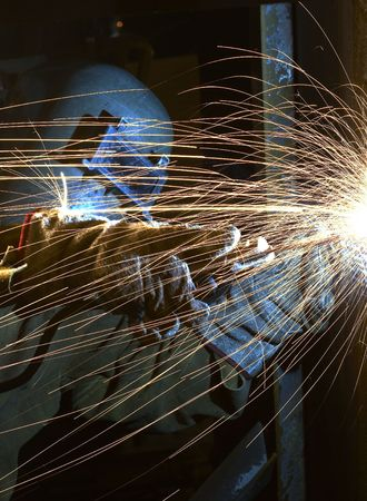 a welder working at shipyard at night