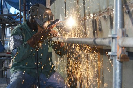 a welder working at shipyard during day shift Stock Photo