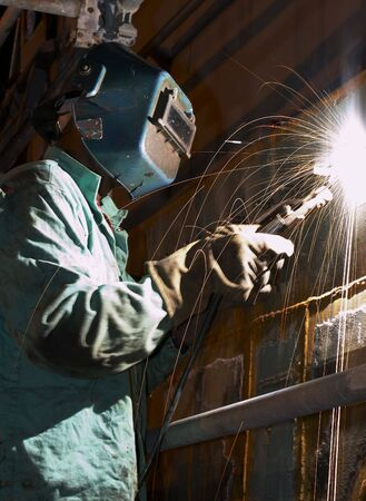 a welder working at shipyard during night shift Imagens