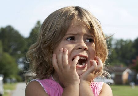 a picture of a cute little girl scared