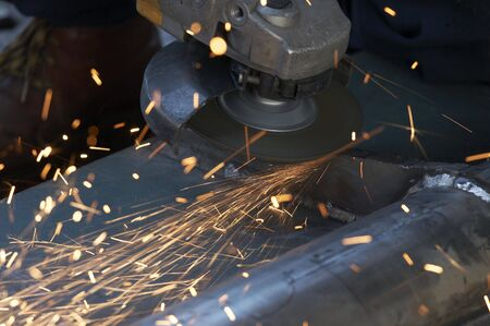 a picture of metal sparks coming from a grinder photo
