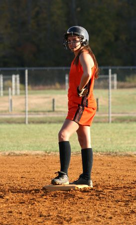 fastpitch: a fastpitch softball player on second base