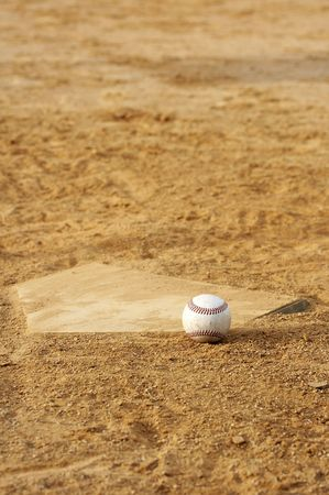 one baseball on home plate at a sports field Stock Photo - 3596296