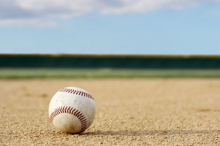 one baseball on infield of sport field Stock Photo