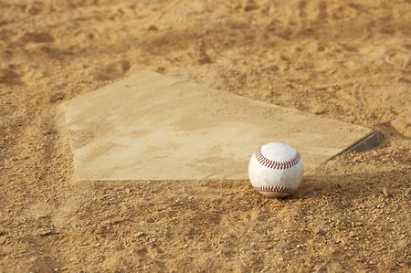 one baseball on home plate at a sports field Stock Photo - 3659840