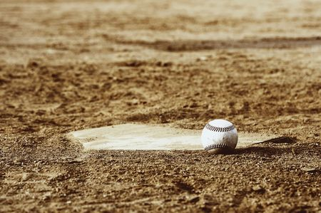 one baseball on home plate at a sports field Stock Photo - 3659841