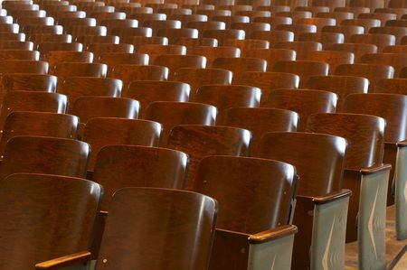 rows of wood chairs in an old auditorium Stock Photo
