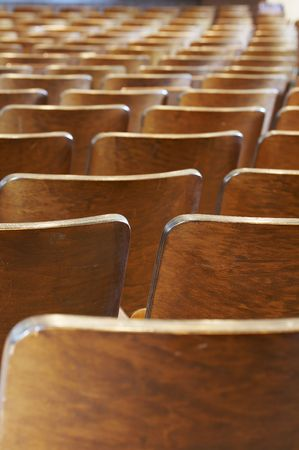 rows of wood chairs in an old auditorium 版權商用圖片