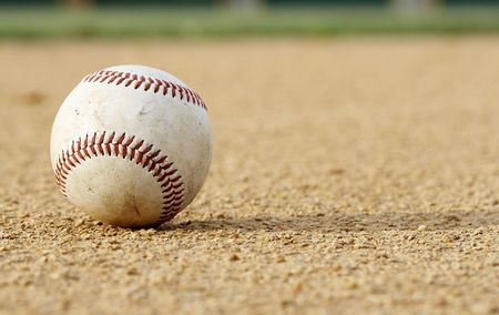 infield: one baseball on infield of sport field Stock Photo