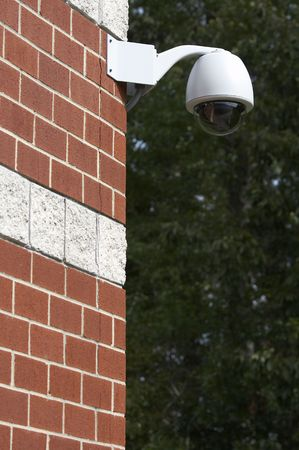 a picture of a surveillance camera on a brick wall Stock Photo - 3776706