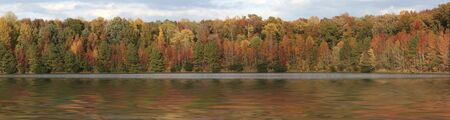 a panorama picture of fall trees over water Stock Photo - 3875227