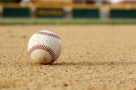 one baseball on infield of sport field photo