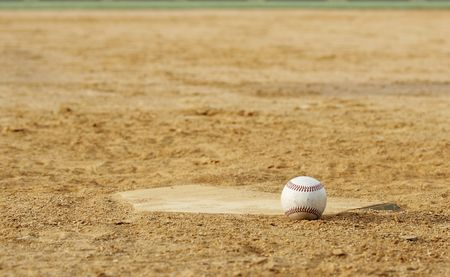 one baseball on infield of sport field Stock Photo - 4063628