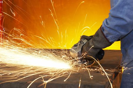 wheel spin: a close up picture of sparks on a grinding wheel Stock Photo