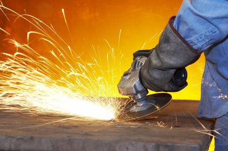 grinding: a close up picture of sparks on a grinding wheel Stock Photo