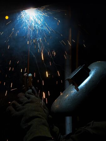 a picture of a welder working at night