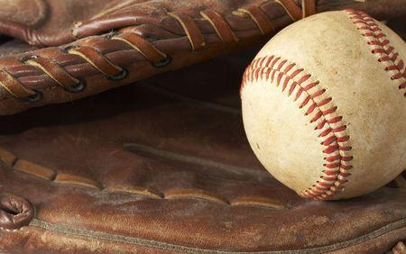 a macro of a baseball in glove