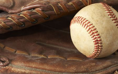 hardball: a macro of a baseball in glove