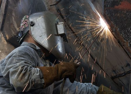 a metal welder busy at work