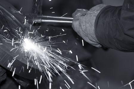 a close picture of a torch cutting steel photo