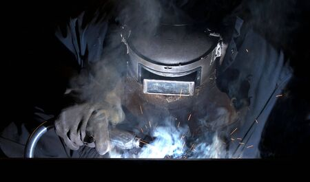 a picture of a welder hard at work Stock Photo