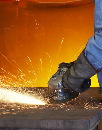 a close up picture of sparks on a grinding wheel Stock Photo