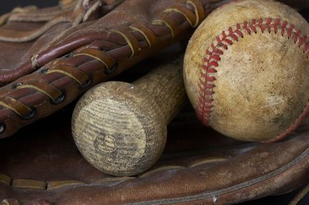 a macro picture of a baseball, glove, and bat Stock Photo - 4580203