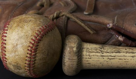 a macro picture of a baseball, glove, and bat Stock Photo - 4580201