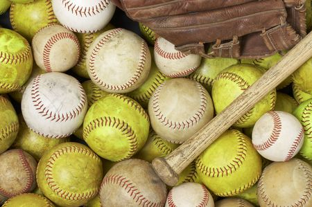 a picture of baseballs, softballs, a bat and glove Imagens