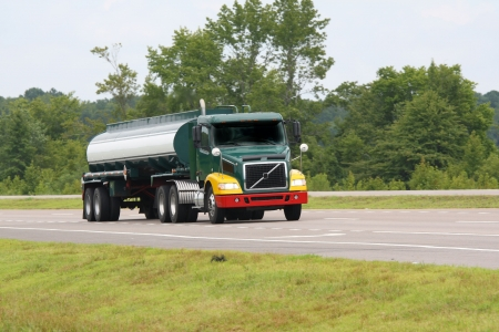 fuel truck on road going to destination photo