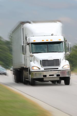 truck driver: white freight truck driving on road